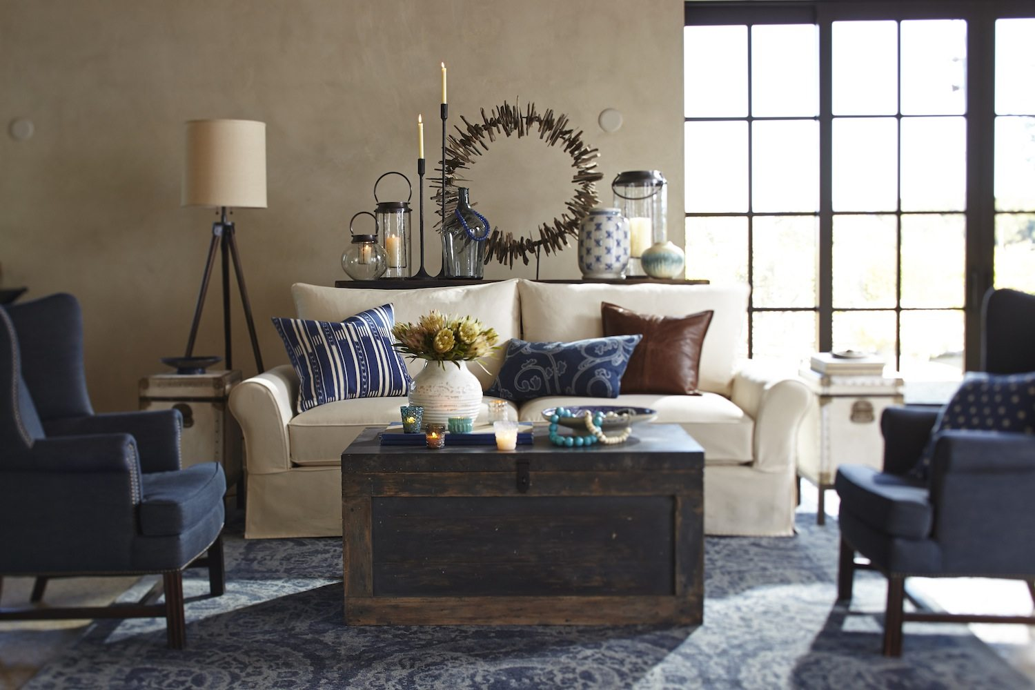 White sofa couch and blue armchairs in a living room from Pottery Barn