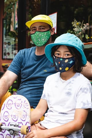 Father and daughter wearing masks from Vistaprint